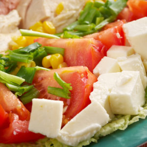 Cobb Salad - Colorful hearty entree sized  salad with bacon, chicken, boiled eggs, corn, -  a main-dish American garden salad